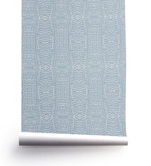 Fauna wallpaper roll on grasscloth.