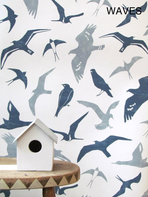 Blue and gray birds in flight on this white wallpaper.