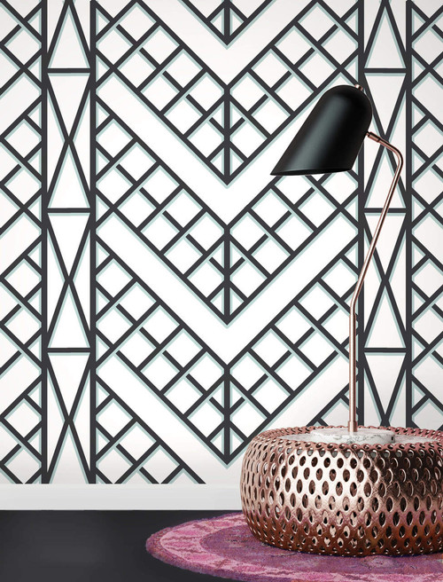 Black and white wallpaper with a trellis pattern.