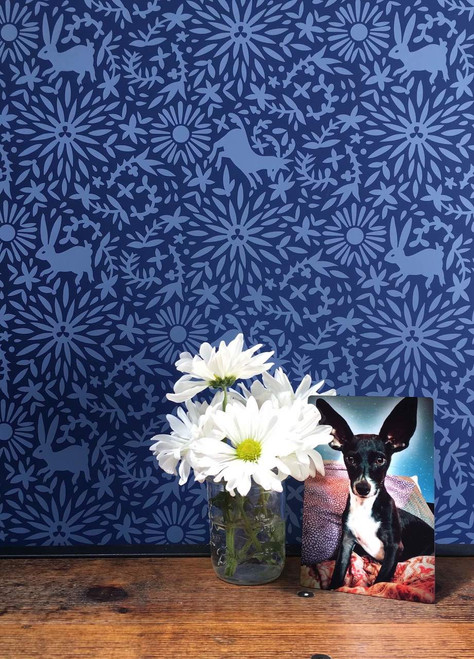 Blue on blue Otomi patterned wallpaper.