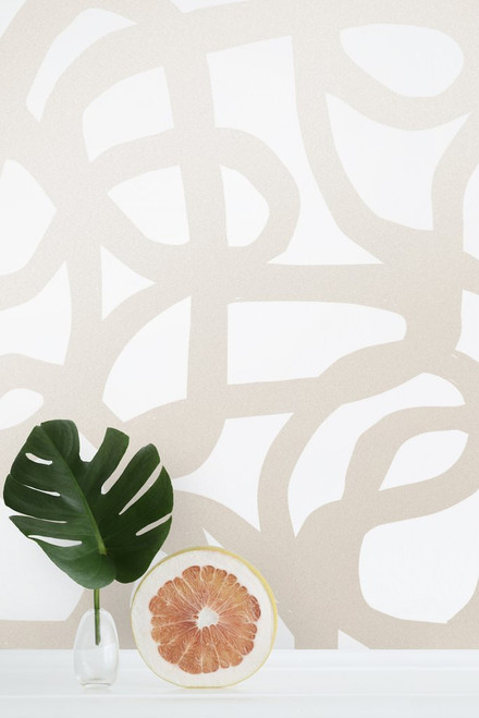 Abstract wallpaper with metallic champagne ink on cream wallpaper.