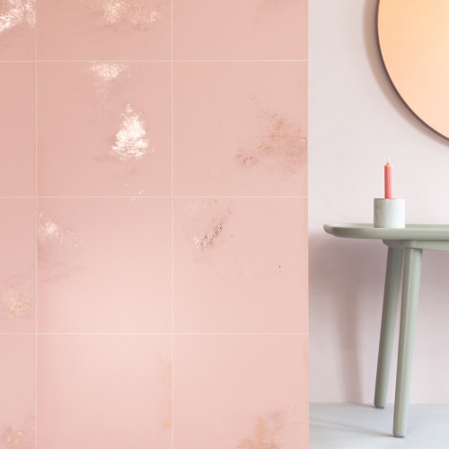 Pink wallpaper with copper fleck with a square line pattern over lay.