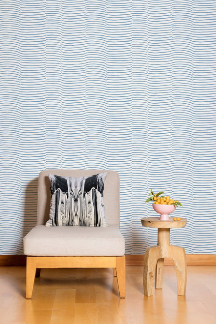 Blue and cream wallpaper with wavy blue pattern.