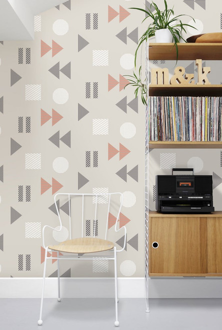 Wallpaper with vintage tape player design in gray and orange.