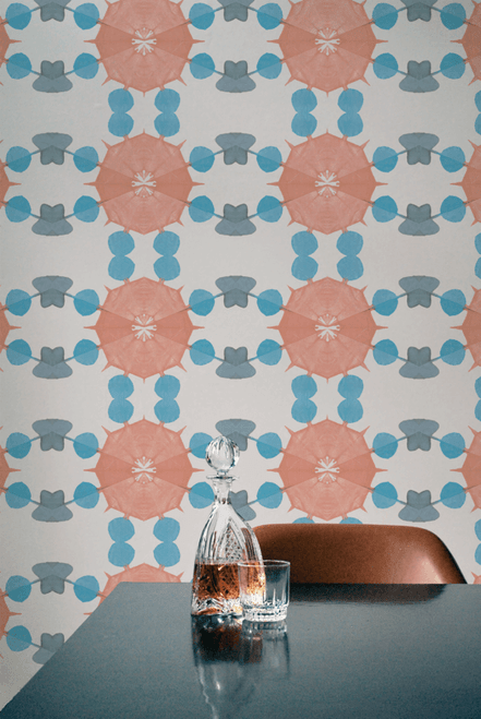 Colorful burst wallpaper in pink and turquoise.