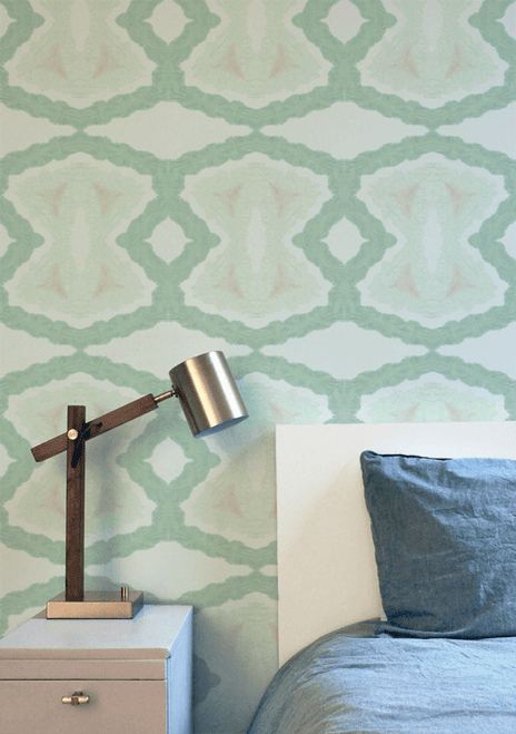 Bold green hand-dyed wallpaper.