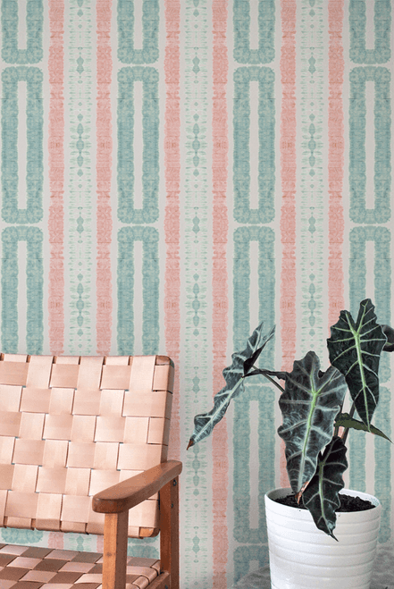 Geometric coastal wallpaper in pink and turquoise.