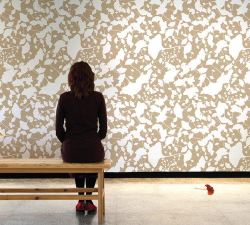 Wall covered in ginkgo leaf wallpaper.