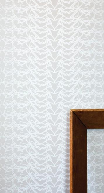 White horses in motion on gray wallpaper.