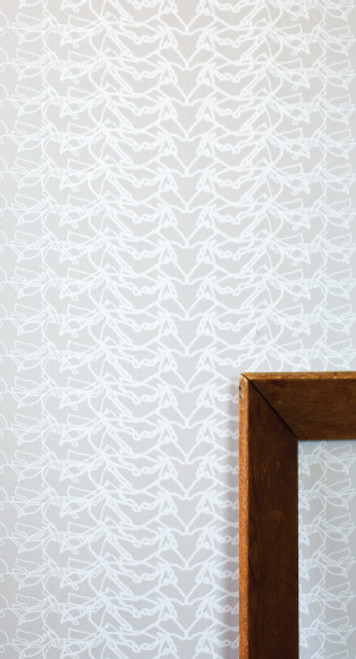 White horses in motion on gray wallpaper.