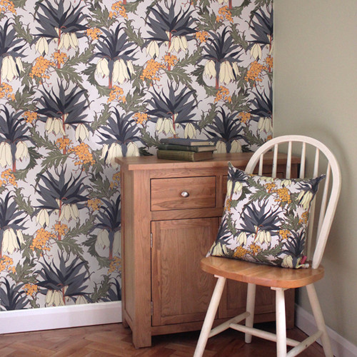 Large Fritillaria blooms grow among delicate blossoms on this floral, slated colored wallpaper.