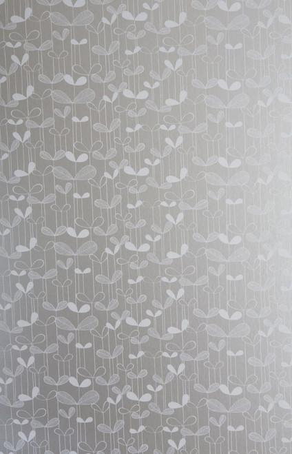 White saplings on silver gray wallpaper.