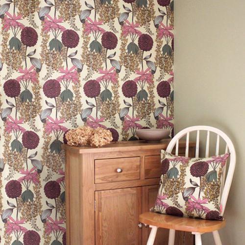 Intricately drawn raspberry colored Laburnum around Rhododendrons and Pom-Pom Dahlias on a neutral wallpaper.