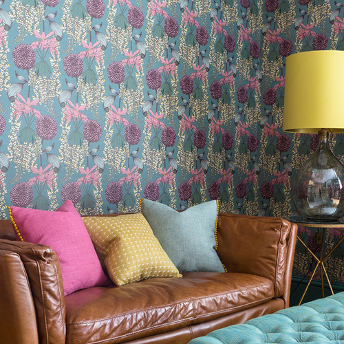 Intricately drawn Laburnum around Rhododendrons and Pom-Pom Dahlias on teal wallpaper.