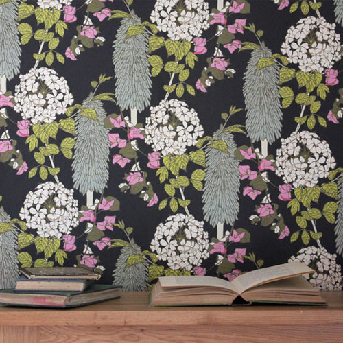 A statement design of Bougainvillea trailing around Polkas flowers on a black wallpaper.