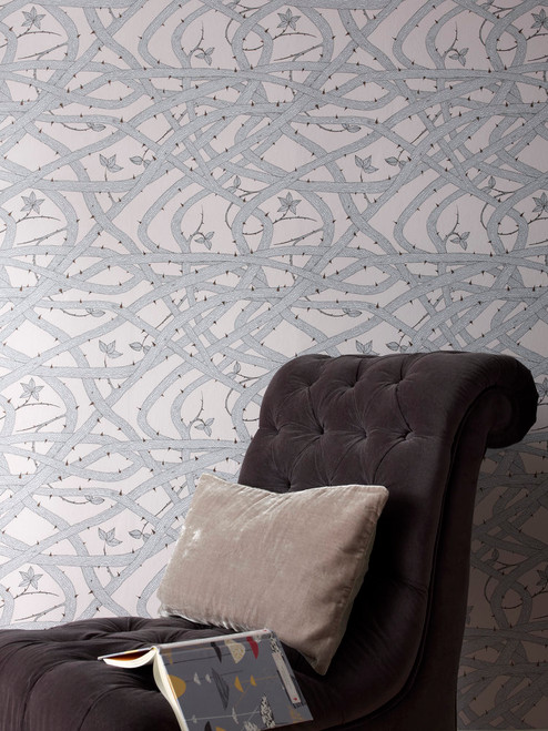 A web of brambles in grey featured in this thorny wallpaper deigned by Abigail Edwards.