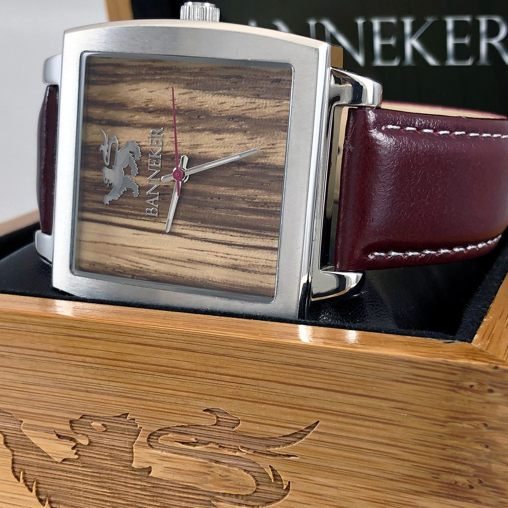 Real Zebra Wood face highlights this timepiece
