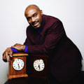 NBA Legend Tim Hardaway wearing the Brown Baller by Banneker on his wrist and leaning on his new Special Edition Hardaway Chiming mantel / desk clock.   This Benjamin Banneker Clock is on sale right now.