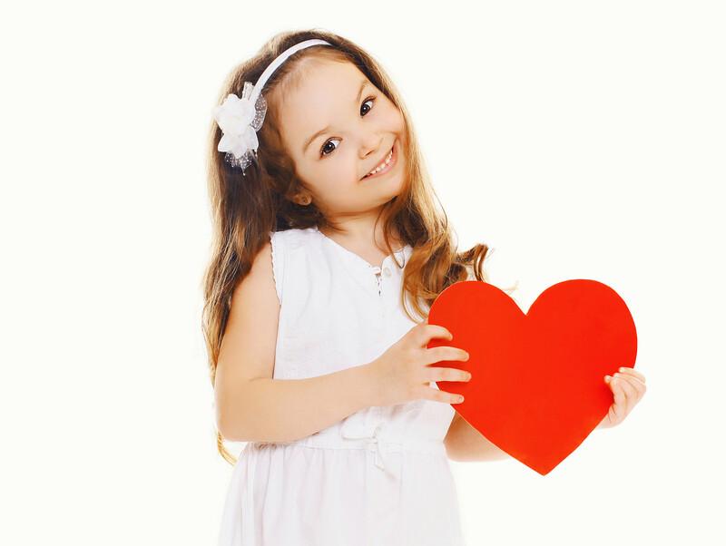 girl-holding-heart-kind.jpg