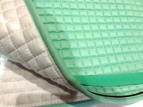Zoom to view this gorgeous mint green saddle pad color and flannel underside.  Note:  flannel underside colors vary and may be different than color shown in this photo.