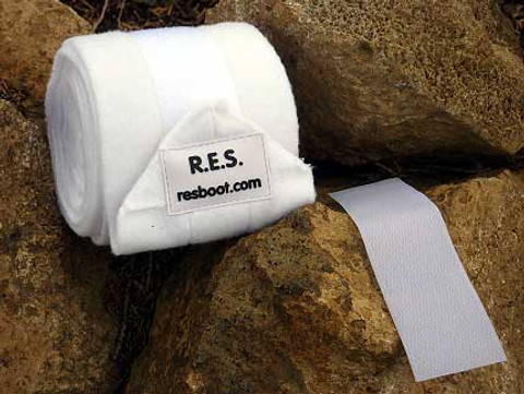 White Polo Wraps with Replaceable Velcro.  Color coordinate your equestrian look by changing the Velcro.