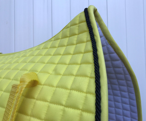 Zoom to view flannel underside of this Yellow Dressage Saddle Pad.  Note: Flannel Underside colors vary and may be a different color than as shown in picture.