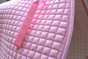 Zoom to view quality and color of this baby pink dressage saddle pad.  Note:  Flannel color may vary from color shown in pictures.