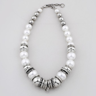 Lustrous white shell pearl and silver bead necklace accentuated with smooth burnished silver plated rings
