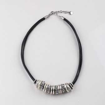 Black multi-strand necklace embellished with burnished silver plated rings and Swarovski® crystals. Length: 46 cm
