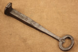Wrought iron railroad spike bottle opener