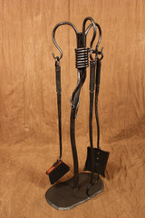 hand-forged iron fireplace tools, vine motif