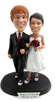 Young couple in converse cake topper
