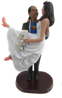 Superman carrying his bride wedding cake topper is sculpted with your faces and hair!