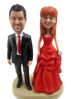 Custom made wedding anniversary cake toppers look like the couple!