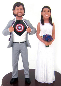 Personalized Captain America Wedding Cake Toppers are sculpted to look like the bride and groom!