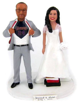 LA Lakers basketball fan groom with short bride on books custom wedding cake topper