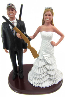 Hunting bride and groom with shotguns wedding cake topper