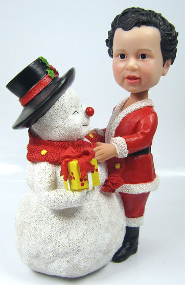 Child Bobble Head figurine with Large Snowman