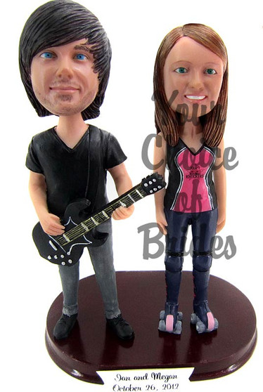 Guitarist groom and bride cake topper