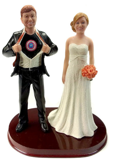 Captain American Wedding Cake Toppers are sculpted to look like the bride and groom. We personalize with your choice of colors.