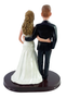 Personalized wedding cake figurines made to look like the bride and groom.