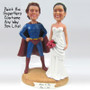 Custom sculpted Superman wedding cake topper