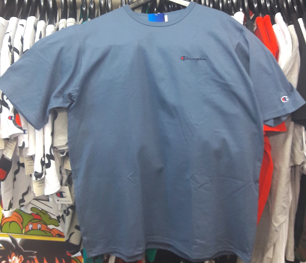 25a15717b16 Champion Clothing. $47.18. Champion Heritage Small Script Blue T-Shirt
