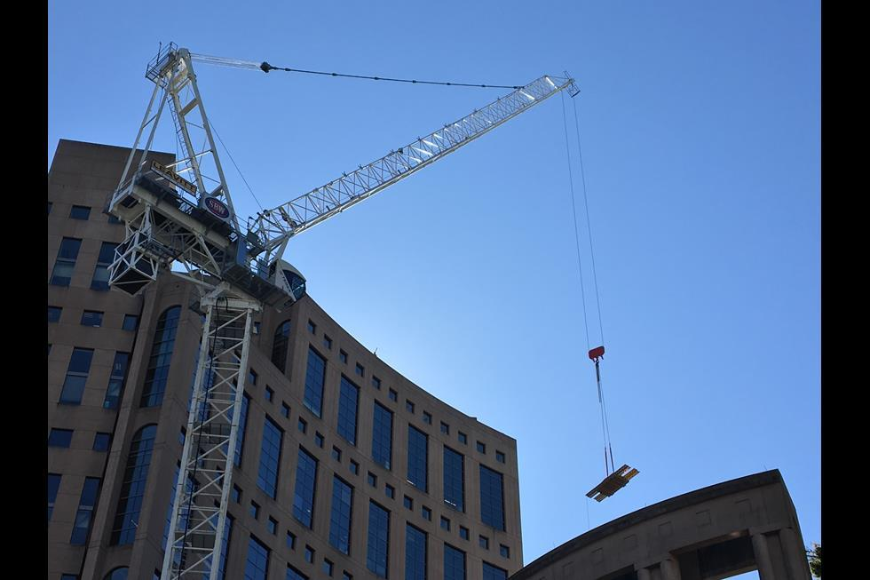 Tower Crane Used To Reconstruct Floors High Above Vancouver Downtown