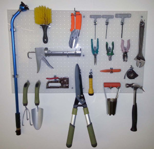 2 Poly Pegboards and 22 Locking Hooks