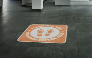 Please Wait Here Bilingual with Shoe Prints Orange - SignCast S200 Virtual Sign