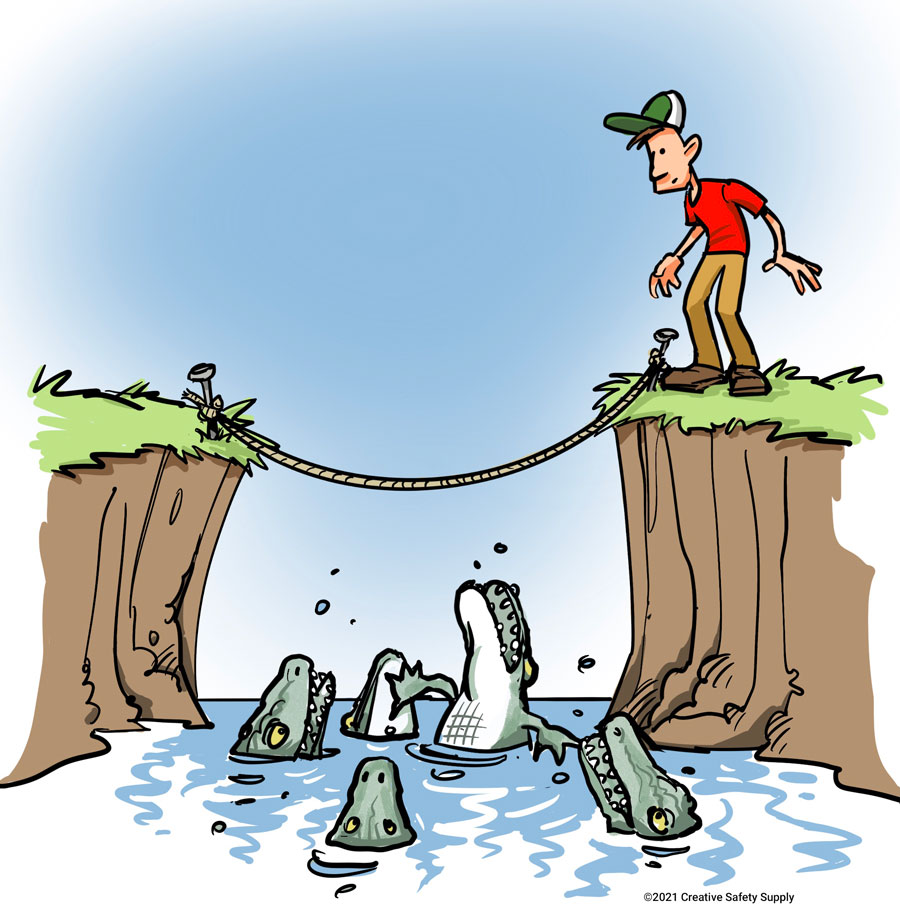 Man stands at the edge on a cliff in front of a tight-rope. Below the tight-rop is a river of crocodiles. Man is looking at the crocodiles and tight-rope.