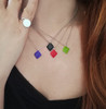 Colorful geometric charm necklace made of silver