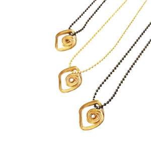 Evil eye pendant with spiral form