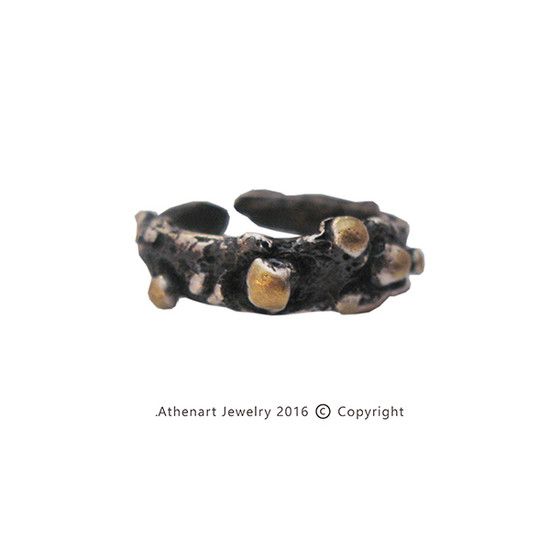 Contemporary silver ring gold and black